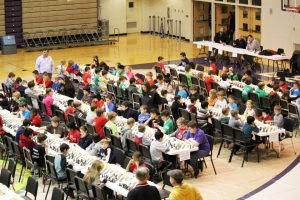 Students sitting playing chess
