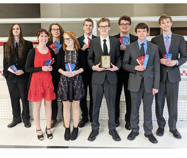 Group of students holding awards. Posing for photo.