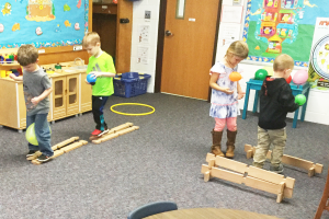 Students standing at table. Looking into telescopes. Title 1 preschool MSD of Martinsville, Martinsville schools, Martinsville, Indiana
