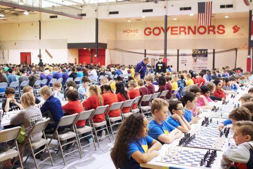 Students sitting and playing chess